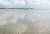 060915-1879 Sky reflected in retreating waves, Cape Canaveral